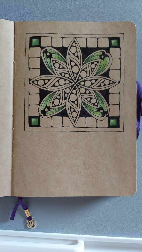 Tangled yogi tutorial Sindoo Flower on kraft journal paper partially colored with Prismacolor pencils